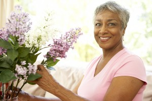 Elderly Black Lady aranging flowers